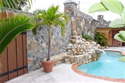 Main Entrance into the Stone Villa pool side. Pool and fire pit included.