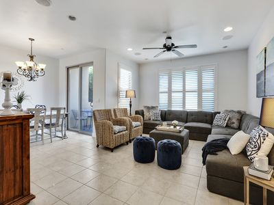 Photo for A block from the beach! Two blocks from downtown! Free WIFI and private parking!