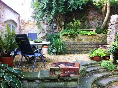 Photo for New! Quirky Garden Apartment in Medieval Square