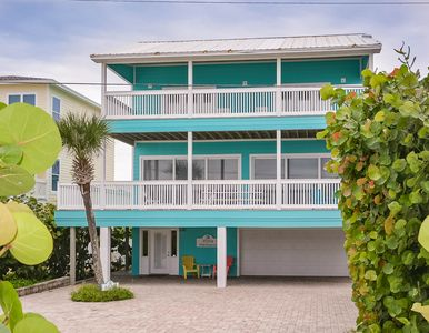 Oceanfront 2 bedroom 2.5 bath beach home on car free beach. Deep 2-car garage.