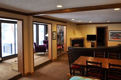 Large, open floor plan, sliding doors open up to the mountain. Amazing location!