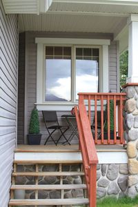 A welcoming front porch is perfect for a morning coffee and the news paper.