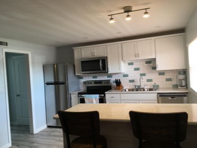 Photo for Newly remodeled beach condo across the street from ocean with onsite pool!!
