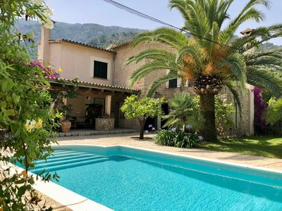 Photo for Stylish renovated villa with big veranda, pool, garden & great mountain views.