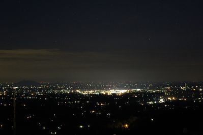 nighttime view from deck overlooking cities below