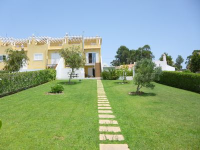 Photo for Albufeira Townhouse with view to the ocean, pool, private garden