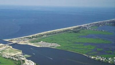 We're located on the beach at the left center of the aerial photo