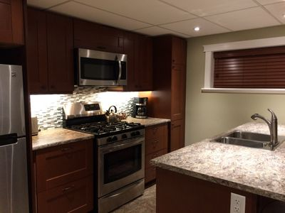 Gourmet kitchen, 5 burner gas range, microwave, dishwasher, fridge, eating bar