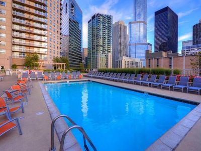 Photo for Urban suite at Grand Plaza w/ lake view, pool, sauna, walk to shopping/dining!
