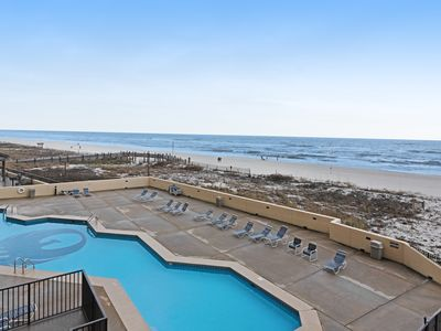 Photo for Waterfront corner condo with gourmet kitchen, pools, gym, hot tub, & arcade