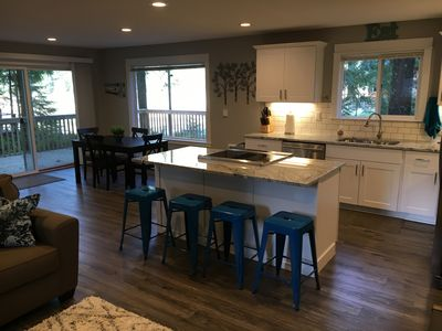 Kitchen with large slider and window over looking the lake