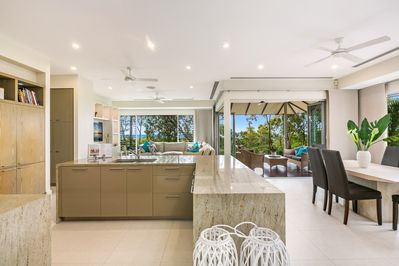 Lounge, dining and kitchen with ocean views.