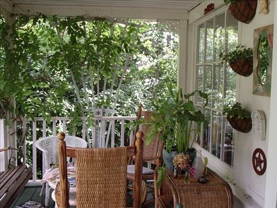 Comfy, private porch off sunroom and dining room.