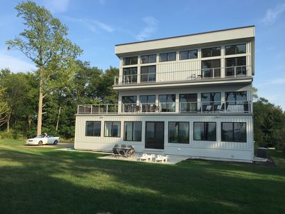 Lakeside with tons of windows, huge 2nd floor deck with sectional and huge table