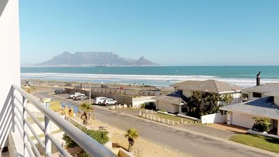 Photo for Condo w/ ocean & Table Mountain views, gas grill and 5 minutes walk to the beach