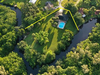 Secluded N Fort Myers Family Home! Solar Heated Pool - .75 Acres w/Canal - Fire Pit - Outdoor Dining