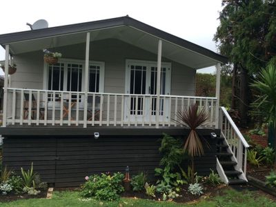 Photo for Cute cottage, quiet setting, easy walk to main st