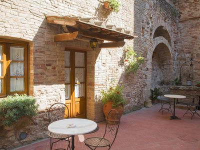 Photo for san gimignano apartment in historical center, courtyard and fast free wifi