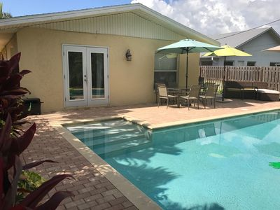 Photo for Beach Cottage with Tropical Pool Oasis One Mile from Vanderbilt Beach