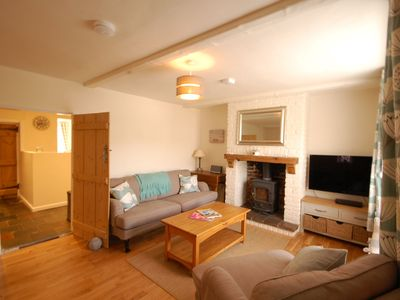 Photo for A beautifully refurbished former fishermen's cottage only 150m from the beach that sleeps 6 guests