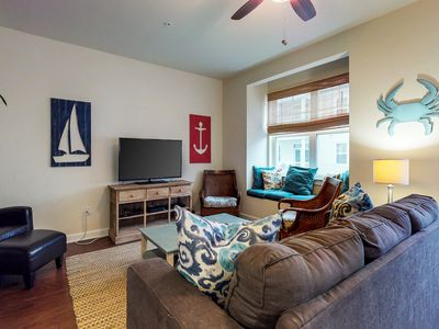 Photo for Beautifully-furnished townhome w/ furnished deck, shared pool - walk to beach