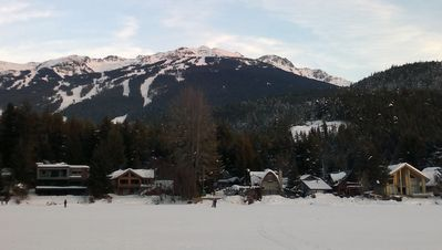 view towards house from frozen lake, Blackcomb in the background.