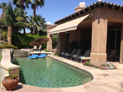 Relax in the salt water pool and spa. Fire pit in background