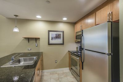 Kitchen - Kitchen- Nicely upgraded with granite counters, and full size stainless steel appliances.