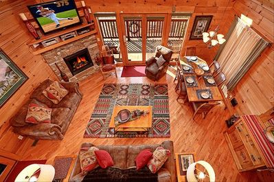 Relax in the Great Room with the inviting luxury decor, huge TV, and views!