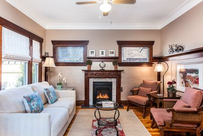 Intimate Living space with ample seating  graced with a carved cherry mantel