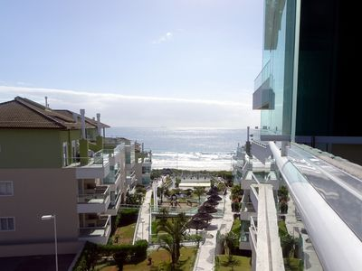 Photo for SPECTACULAR APARTMENT IN THE RESIDENTIAL WATERS SANTINHO CONDOMINIUM!