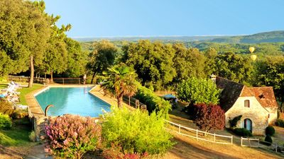 Photo for SARLAT, HAMEAU charming cottages. 25m pool overlooking the valley of DORDOGNE