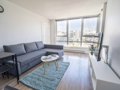 Photo for Downtown Condo next to BC Place+Free Parking+AC, Sleeps 4&more!