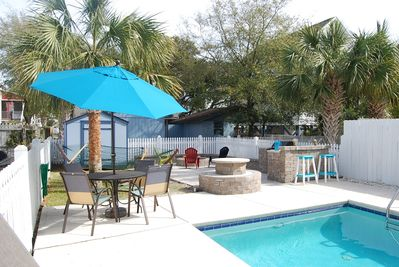 Relaxing backyard oasis, includes fire pit, backyard gas grill and bar area.