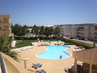 Shared pool area has large pool and children's pool and lots of sun loungers
