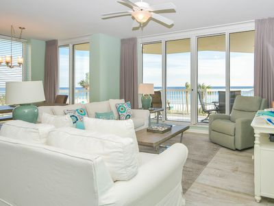 Photo for Colorful beachfront condo w/a large wrap-around balcony!