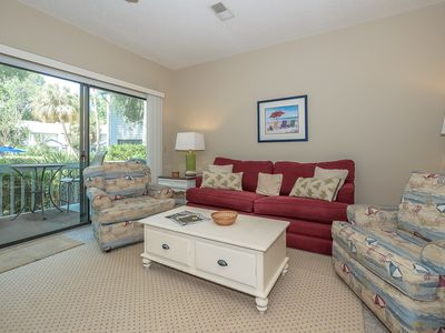 Just steps to the pool, minutes to the beach, charming Ocean Breeze Villa.