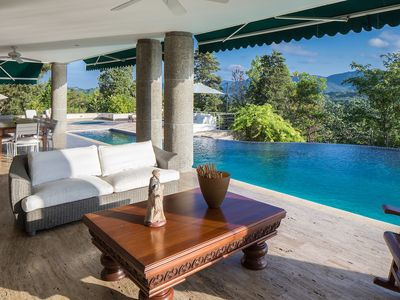 Photo for Compostela is a designer villa with stunning mountain views, sauna, pool and gym