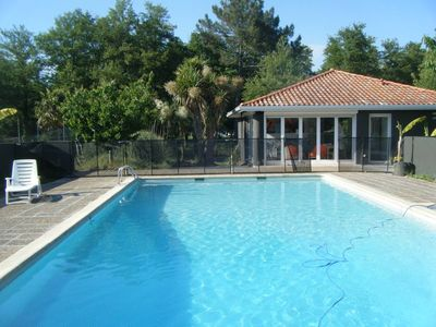 Photo for House with swimming pool view of Soustons lake near sea, internet wifi, air conditioning