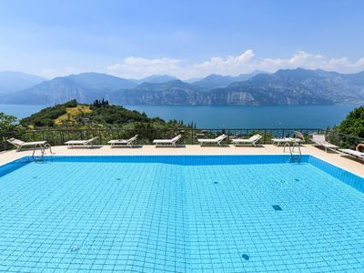 Photo for Relax in this quite resort high above Lake Garda!