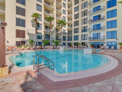Photo for Right across the street from the beach & restaurants, with shared pool & hot tub