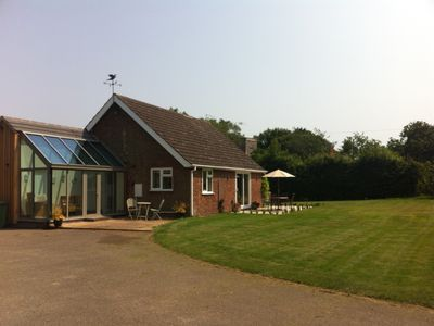 Photo for Refurbished holiday home in secluded 3/4 acre garden.