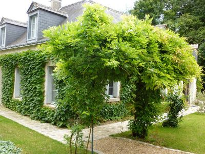 Photo for in the heart of a historic village of Touraine, with large garden and grove.