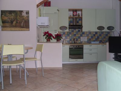 Photo for A well appointed air-conditioned apartment with WIFI, located near the sea