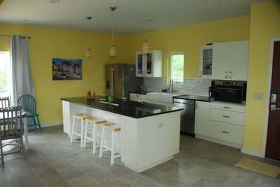 Kitchen with Dishwasher, Micowave, Oven, Stove top, Refrigerator. Much storage.