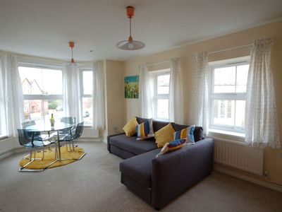 Photo for In the centre of Sheringham opposite St. Peters Church, open plan living at its best!