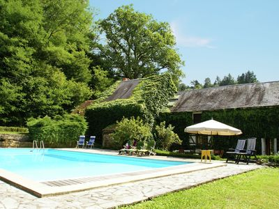 Photo for Detached holiday home with private swimming pool and large garden in Moulin-Engilbert