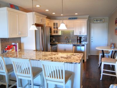Sunny decor perfect for families in this beautiful condo on the beach!