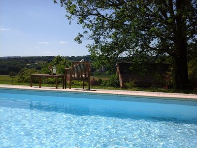 Relax by the pool with a wonderful view over the Chateau de Belcayre