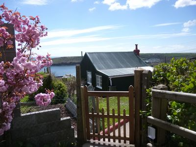 Approach to the property with beautiful sea views in the background